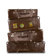 Pile of retro suitcases, isolated on white background
