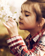 Little Girl smelling Cherry Blossoms