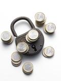 old padlock with coins euro - vecchio lucchetto con euro