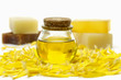 bottle of massage oil and handmade Soap on yellow flower peals