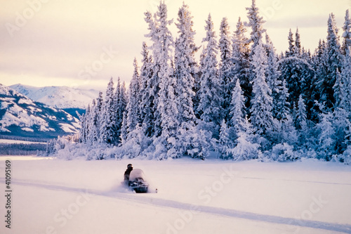 Winter snow sports on a snowmobile
