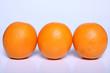 three fresh orange fruit in white
