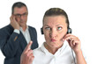 Beautiful business woman with headset and talking to a businessm