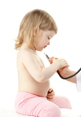 Doctor examining little girl