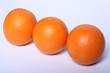 three fresh Orange fruit isolated on white