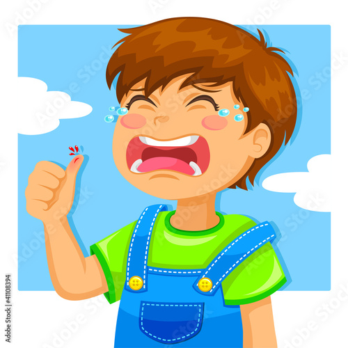 kid crying because of a cut on his thumb