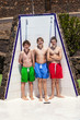 boys have fun unter the pool shower