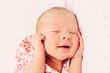 Adorable sleeping newborn baby girl