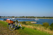 Dutch river landscape with bicycles
