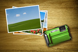 green camera with photos