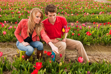 Young couple in Dutch flower fields