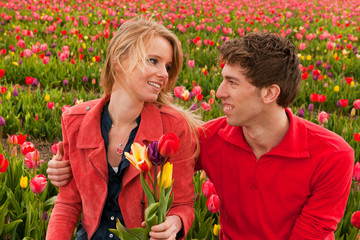 Happy young couple in Dutch flower fields