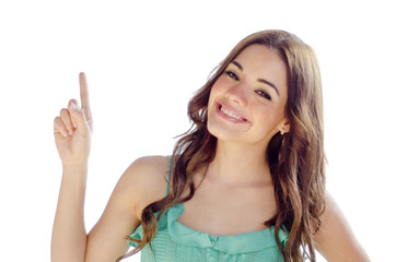 Cute young woman pointing at copy space