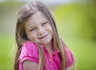 Adorable little girl outdoor portrait