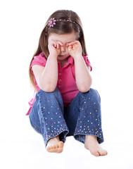 Sad little girl isolated on white