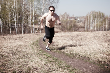 Jogging, focus on the gravel path, blurred motion