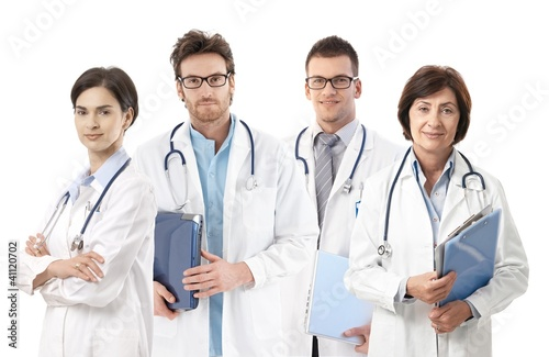 Group portrait of doctors on white background