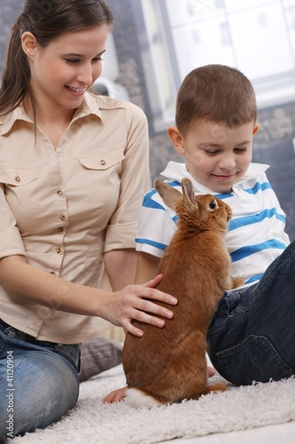 Mother and son with cute pet bunny