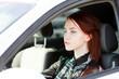 Pretty teenage girl in a car