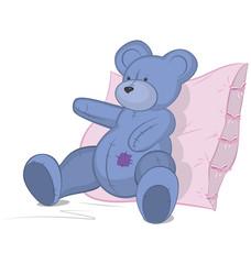 Blue Teddy bear on pink pillow