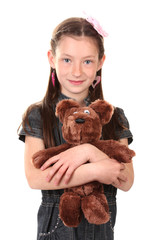 Portrait of beautiful little girl with toy bear