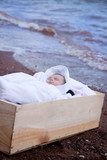washed up baby in wooden box