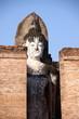 Statue of ancient buddha in Sukhothai historical park, Thailand