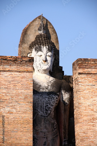Statue of ancient buddha in Sukhothai historical park, Thailand
