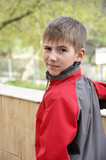 cute boy in red jacket