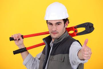 craftsman holding a spanner and making a thumbs up sign
