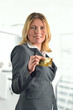 Attractive business woman holding an credit card
