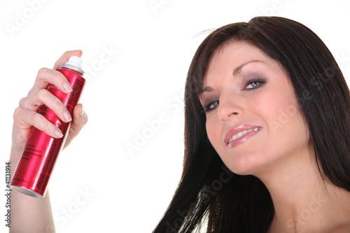 Woman with spray deodorant