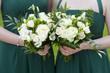 bridesmaids hold flowers