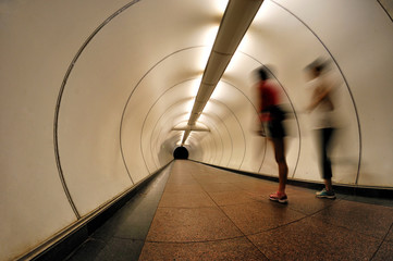 Joggers running through a tunnel