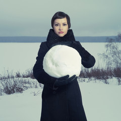 Woman with snow ball