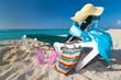 Empty deckchair with sun accessories on the Caribbean beach