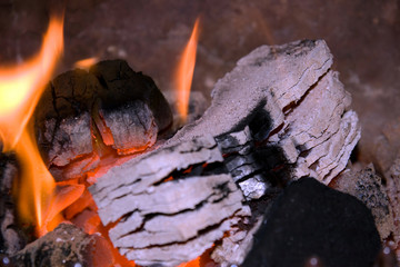peat briquettes burning white hot