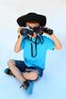 Kind mit Fotokamera