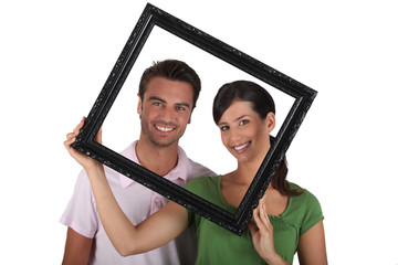 Silly couple with picture frame
