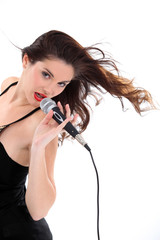 Brunette singing into microphone