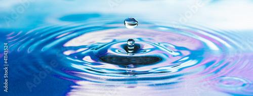 Drop of pure fresh water falls in water © Kuruan