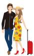 スーツケースをもつカップル