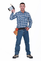 Handyman holding blow torch