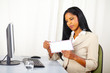 Executive woman opening a letter