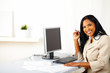 Young businesswoman on work desk