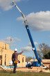 Foreman giving directions to crane operator