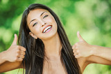 woman with bare shoulders happily raises his thumb up