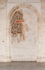 Semicircular niche with fresco remains in medieval church