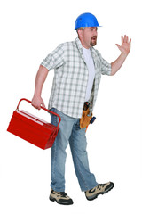 Worker with a toolbox waving