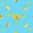 Repeatable pattern of a yellow butterfly with roses